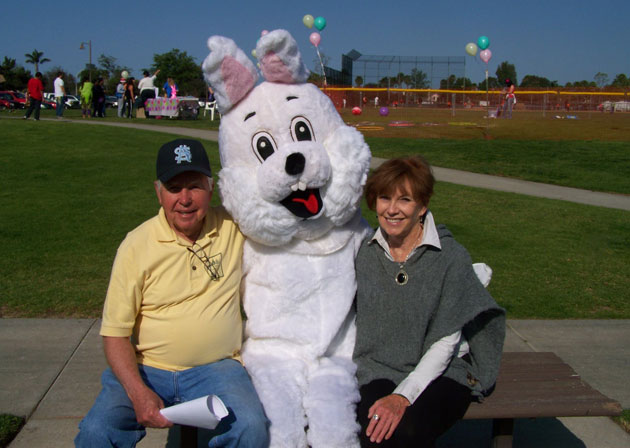 Rotary Club of Goleta's Lynn Cederquist and Pat O'Malley are all smiles for a photo opportunity with a friend who is all smiles and all ears.