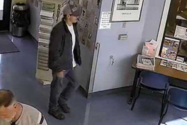 Authorities are searching for the man wearing the dark jacket and cap in this photo taken from a surveillance video at the Santa Barbara County Animal Services shelter in Santa Maria. The man is a suspect in the Thursday afternoon dognapping of a 7-month-old pit bull at the facility.