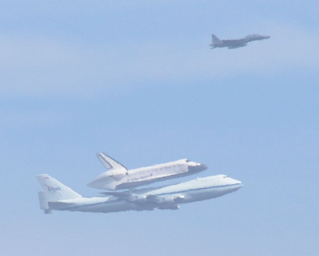 The space shuttle Endeavour and its carrier climb from Vandenberg Air Force Base toward Los Angeles at 11:25 a.m. Sept. 21, 2012, on its last flight. This photo was taken from Ocean Avenue west of Lompoc (34° 39' 41.41