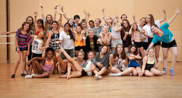 Students enrolled in the Santa Barbara Dance Arts/Arts Mentorship Program Master Class pose for a picture in their new facility, along with guest choreographer Lauren Froderman. (Rod Tucknott photo)