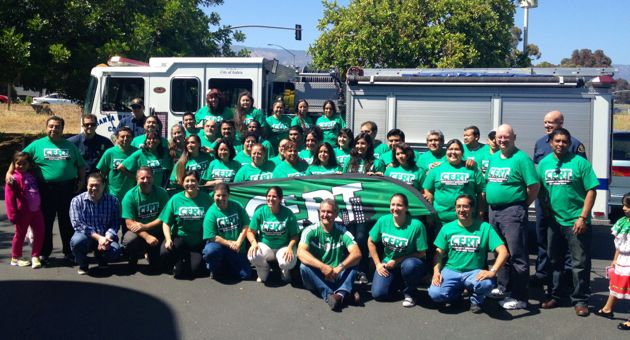 Graduates of the first-ever Spanish-language 'Train-the-Trainer' CERT class pose with a Santa Barbara County Fire Department truck outside Goleta City Hall. (Goleta Prepare Now CERT photo)