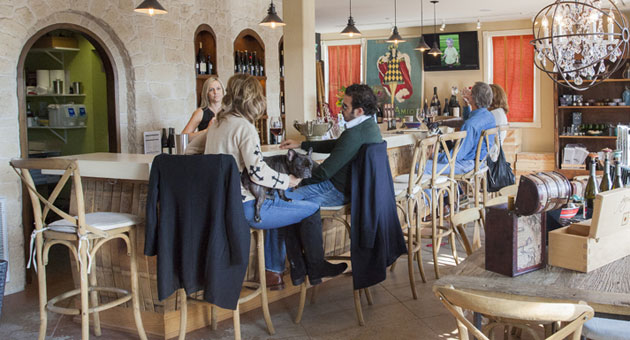 Summerland Winery offers a spacious tasting room with high back bar stools and boutique-type items for sale in every nook and cranny. (Tara Jones photo / Eat This, Shoot That!)