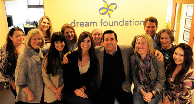Some of the smiling Dream Foundation staff who help make the magic happen: From left, Shersy Benson, Carol Brown, Rachel Stelle, Katrina Viola, Kelly Sweda, Emily Mullranin, Cindy Hellriegel, Thomas Rollerson, Lori Thiel, Bob Howard-Anderson, Barbara Schoch and Sonia Salazar.
