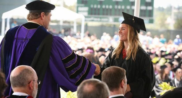 <p>Westmont College President Gayle Beebe shakes hands with the newest graduate from the Class of 2014 during Saturday's commencement at Carr Field. (<a href=