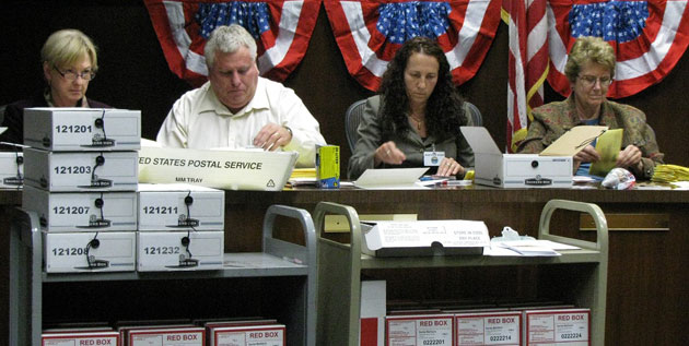 City staff members count ballots late into the night Tuesday at City Hall. From left, the Santa Barbara Airport's Hazel Johns, Gary Harwell, labor negotiator Kristy Schmidt and airport director Karen Ramsdell.