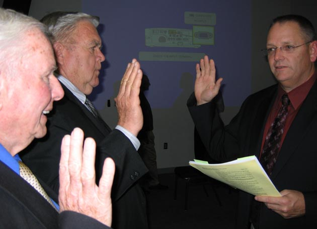 Santa Maria Joint Union High School District Superintendent Mark Richardson, right, swears in recently re-elected trustees Jack Garvin, left, and Victor Tognazzini. (Santa Maria Joint Union High School District photo)