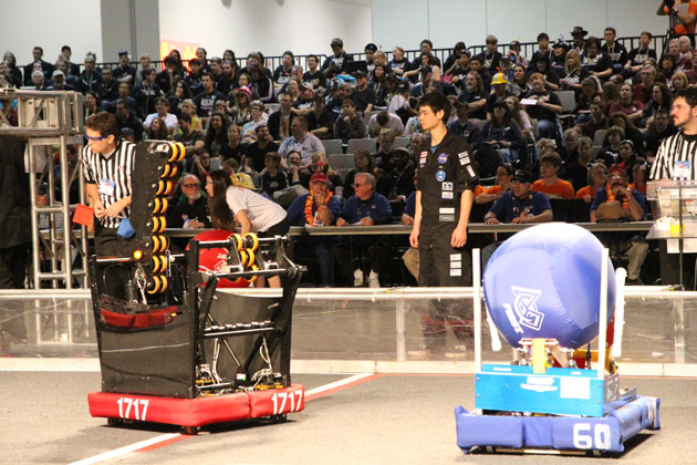 DPEA student Jieh Meinhold stands ready to assist the Team 1717 robot during championship action at the Las Vegas FIRST Robotics championship.