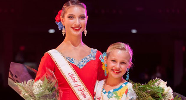 <p>Beaming with pride, Talia Ortega Vestal, left, and Natalie Mowers get their first of many official photo opportunities as 2014 Spirit of Fiesta and Junior Spirit, respectively.</p>