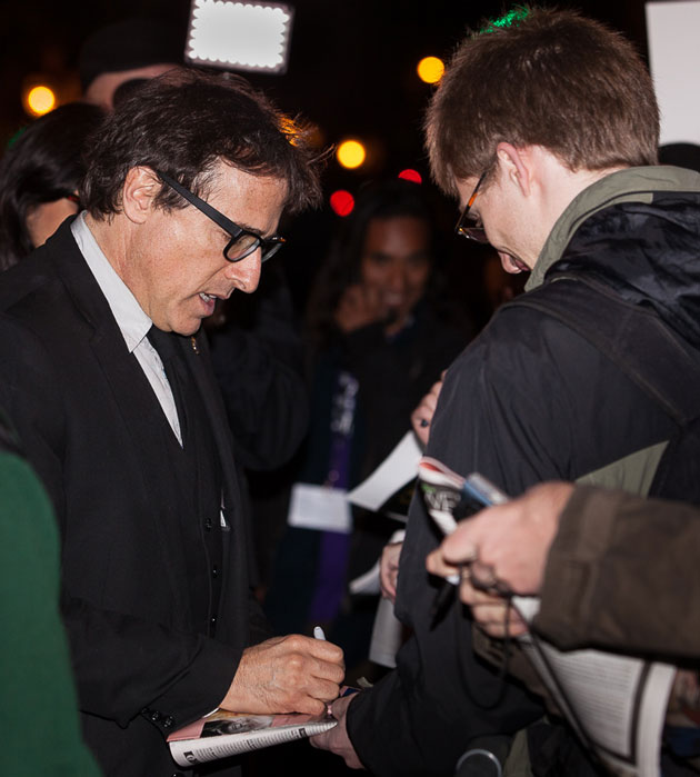 Director David O. Russell signs autographs outside the Arlington Theatre in Santa Barbara. (Fritz Olenberger photo / www.olenberger.com)