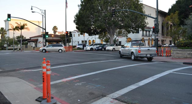 Contractors installing new traffic signals at the intersection of Anacapa and Carrillo streets accidentally severed a fiber-optic cable when they dug a hole for a signal pole. The damage caused an additional $50,000 in expenses for the $750,000 project. (Giana Magnoli / Noozhawk photo)