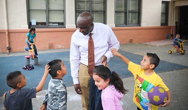 Nuh Kimbwala interacts earlier this year with students at Harding University Partnership School in Santa Barbara. Kimbwala was placed on paid leave this week following an undisclosed incident that is being investigated. (Lara Cooper / Noozhawk file photo)