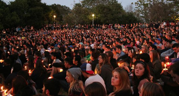 Thousands of people filled the Anisq'Oyo' Park amphitheater in Isla Vista on Saturday night for a candlelight vigil that started at UC Santa Barbara's Storke Plaza. The vigil was meant to honor and remember those killed and wounded in a horrific rampage through the densely packed community the night before. (Joshua Molina / Noozhawk photo)