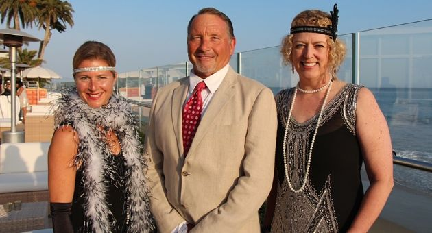 Santa Barbara Montessori School head of school and co-founder Jim Fitzpatrick is flanked by event chairwoman Caroline Powers, left, and online auction chairwoman Audrey Weiss at the Great Gatsby-themed annual Auction Extravaganza held Saturday at the Coral Casino Beach & Cabana Club. (Melissa Walker / Noozhawk photo)