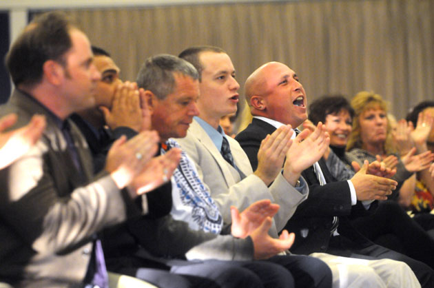 Rescue Mission men's program graduates cheer each other on during Saturday's ceremony.
