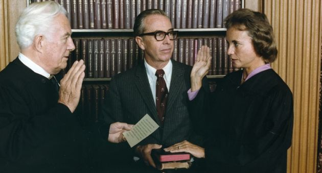U.S. Supreme Court Justice Sandra Day O'Connor is administered the oath of office by Chief Justice Warren Burger, with her husband, John, looking on. O'Connor became the court's first woman member after being nominated by President Ronald Reagan in 1981. (Ronald Reagan Presidential Foundation and Library photo)