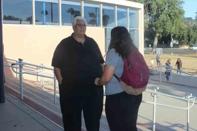 <p>Dos Pueblos High School student interpreter Aranzau Herrera Magallanes talks to Jesus Aguilar, an adult interpreter, about the school's program, which previously had provided interpreters for Spanish-speaking parents at back-to-school nights.</p>
