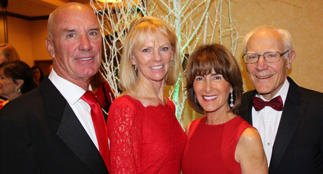 From left, 2013 Abercrombie Community Excellence Award winners Tom and Susan Parker and Anne Smith Towbes, with her husband, Michael Towbes, the 2004 honoree, at the United Way of Santa Barbara County's 17th Annual Red Feather Ball. (Melissa Walker / Noozhawk photo)