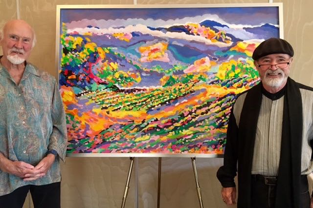 Archie McLaren, right, founder and chairman of the Central Coast Wine Classic, with artist James Paul Brown, whose neo-impressionist oil painting of a vineyard and mountain scene was the centerpiece of an auction benefiting the organization.