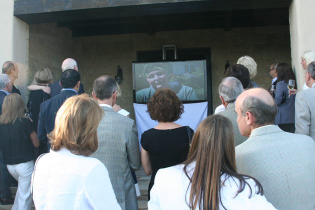 Guests watch a video presentation detailing some of the programs offered by Hospice of Santa Barbara.