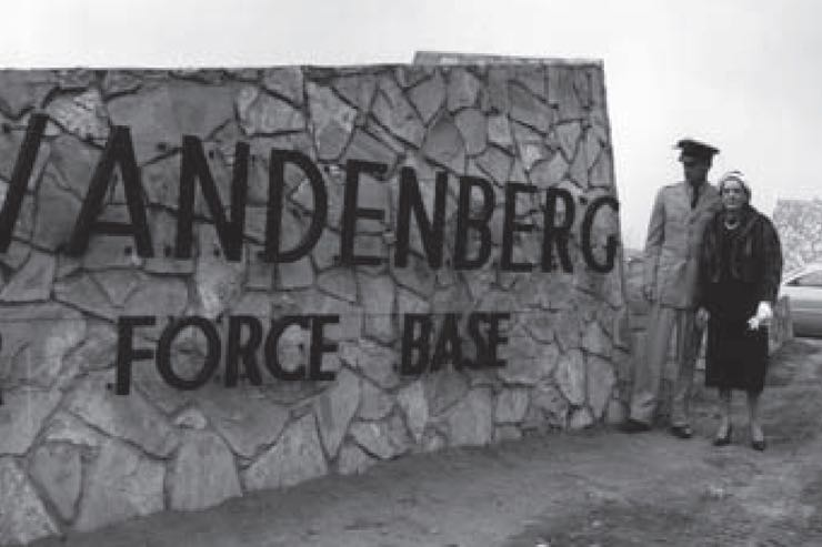 A 1958 Air Force photo shows Capt. Hoyt S. Vandenberg Jr. and his mother, Gladys Rose Vandenberg, at the main gate's entry sign. Cooke Air Force Base was renamed after Vandenberg's father, Gen. Hoyt S. Vandenberg, who died in 1954.