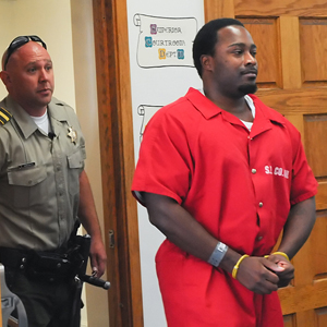 Lanie Tyrone Richardson is escorted from court after a hearing. He is charged with murder in the car-surfing fatality of Allison Meadows, 26, of Santa Barbara. (Lara Cooper / Noozhawk photo)