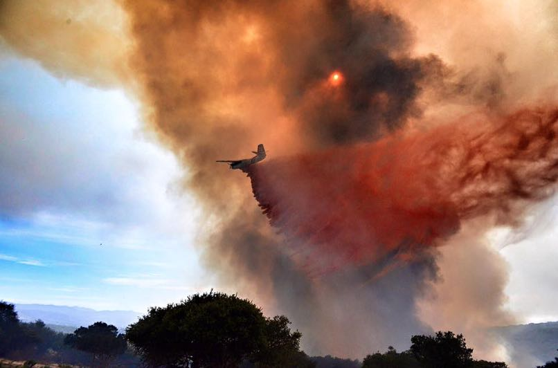 A bomber drops fire retardant on the wildfire burning June 29 in the Burton Mesa area near Lompoc. Full containment is expected June 30.
