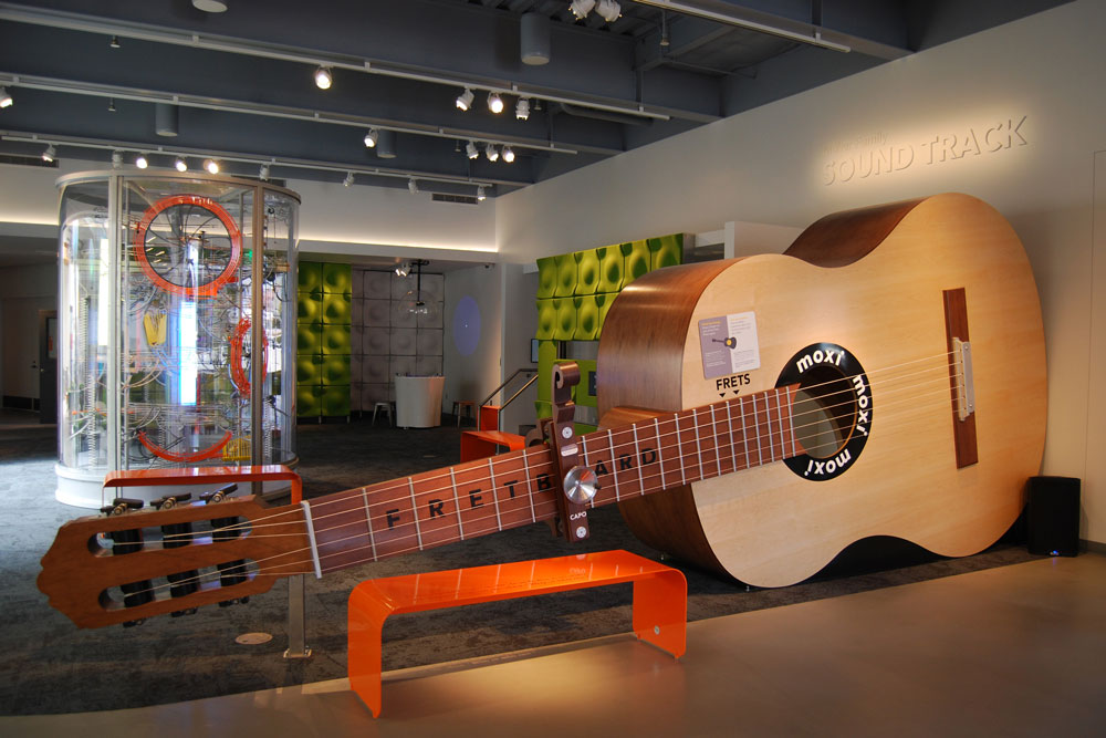 A giant guitar helps visitors learn about music and sound at MOXI, The Wolf Museum of Exploration + Innovation, in Santa Barbara.