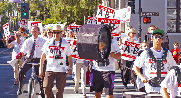 Student drummers lead the way as an enthusiastic crowd marches down State Street in Santa Barbara on Wednesday in support of Measures A and B, school parcel-tax proposals on the Nov. 6 ballot. (Tom Bolton / Noozhawk photo)