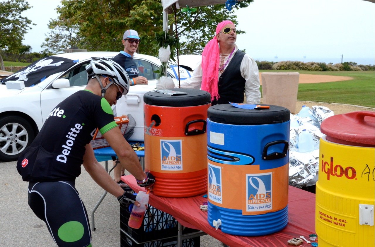 A rider stops for some liquid refreshment.