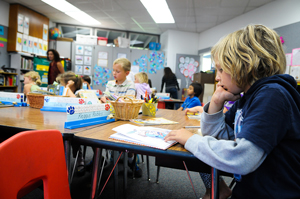 A student a Mountain View School in Goleta reads during class Thursday. (Lara Cooper / Noozhawk photo)