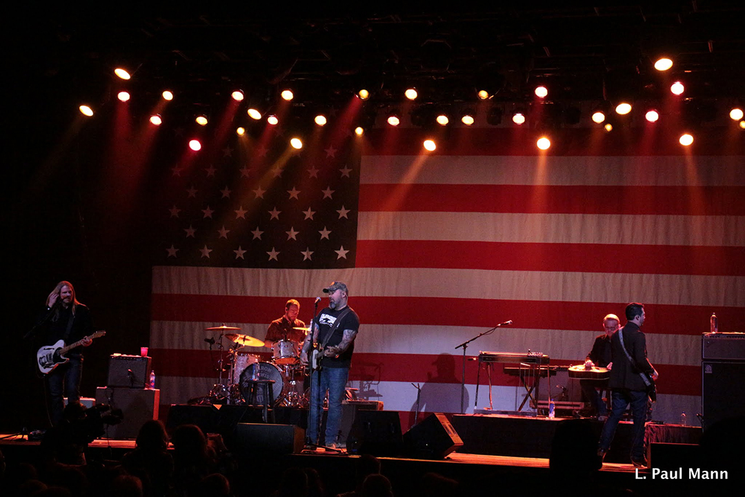A massive American flag served as a backdrop for Lewis's performance.