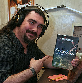 Bluesman Allastair Greene was happy to read from Ted Gioa's book, 'Delta Blues: The Life and Times of the Mississippi Masters.'