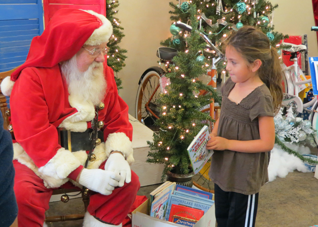 <p>Santa handed out books Sunday at the Santa Maria Shopping Center to visitors of Santa Maria&#8217;s Festival of Trees, put on by Altrusa of the Central Coast to raise money for local scholarships and grants.</p>