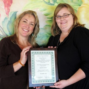 Amy Evans, left, presents Kristina Keim with the 2011 Devereux Culture of Caring Award.