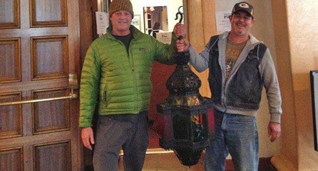 <p>Michael Junk and Tom Houghtaling found this lamp, stolen from the Arlington Theatre in 2011, at a garage sale and returned it to its rightful place.</p>