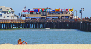 Sunbathers enjoy a beautiful day on the sand near Stearns Wharf in Santa Barbara Tuesday, conditions that forecasters say are expected to last through the weekend. (Tom Bolton / Noozhawk photo)