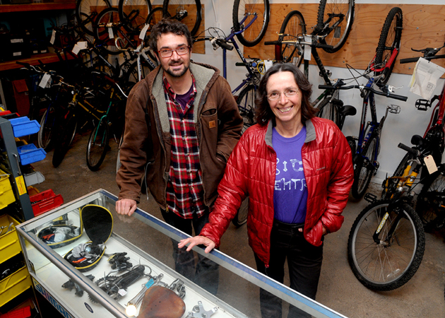 Bici Centro's Ed France and Christine Bourgeois in the organization's brand-new space on East Haley Street in Santa Barbara. (Lara Cooper / Noozhawk photo)