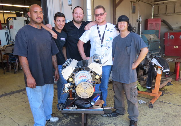 Hancock College automotive technology students, from left, Arthur Olivo, Troy Showalter, Kevin Strawder, David Fletcher and Tom Yee have worked since the summer to build an engine for an auction to benefit the Blain Johnson Memorial Foundation. (Gina Potthoff / Noozhawk photo)