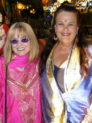 Penny Little, left, and Claudia Bratton wear East Indian attire for last year's Summer Solstice fundraiser at India House.