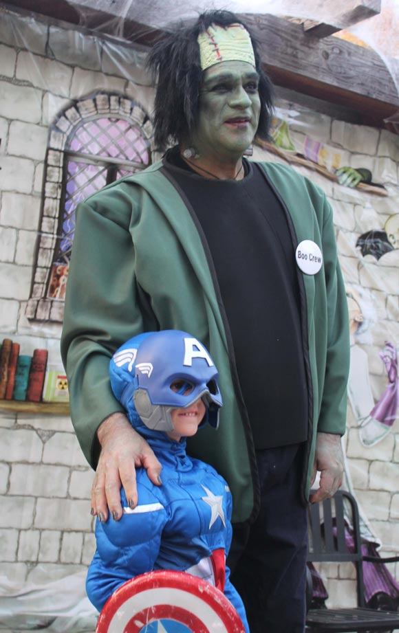 A member of the Boo Crew dressed as Frankenstein meets with a wee Captain America at Boo at the Zoo.