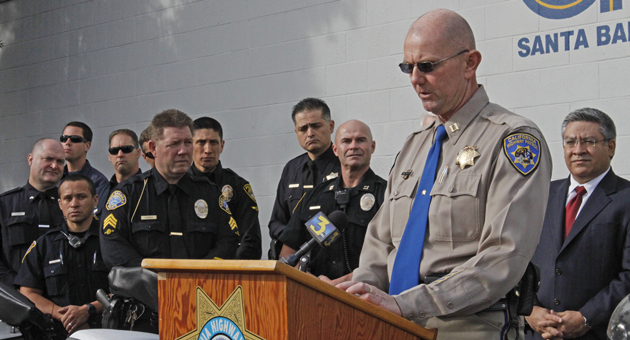 At a Friday news conference, California Highway Patrol Capt. Marty Maples explains that local agencies will be stepping up enforcement of DUI laws during the holiday period. (Gabriella Slabiak / Noozhawk photo)