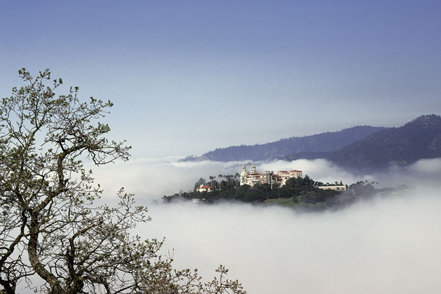 The iconic Hearst Castle rises out of the fog near the quaint coastal community of Cambria.
