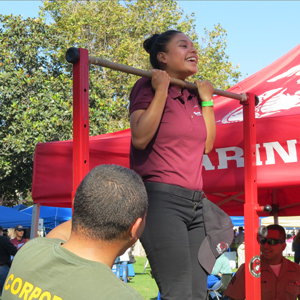 Grizzly Youth Academy junior Priscilla Quinteros tries a pull-up at the U.S. Marines tent during Allan Hancock College's Career Exploration Day on Friday. (Gina Potthoff / Noozhawk photo)