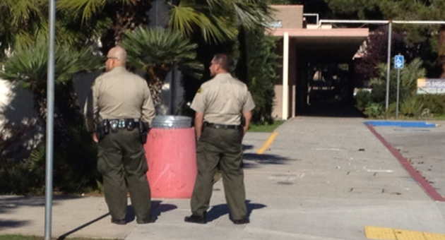 <p>Santa Barbara County sheriff&#8217;s deputies keep watch at Santa Barbara Charter School on Thursday after a man reportedly threatened to kill his two children who attend school there.</p>