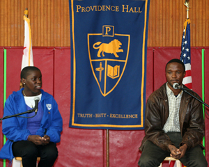 Phiona Mutesi, left, and coach Robert Katende speak to students at Providence Hall. (Melissa Walker / Noozhawk photo)