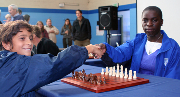 Providence Hall seventh-grader Zackery Nikola, 12, challenged Ugandan chess prodigy Phiona Mutesi to a friendly game during a recent visit to the Santa Barbara school. (Melissa Walker / Noozhawk photo)