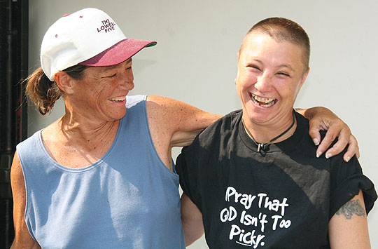 Chris, left, and July share a happy moment at Casa Esperanza last year. The two homeless women's stories defy simple stereotypes, yet while July's latest chapter has an unknown outcome, Chris' ended badly: She recently died of a seizure while in jail.