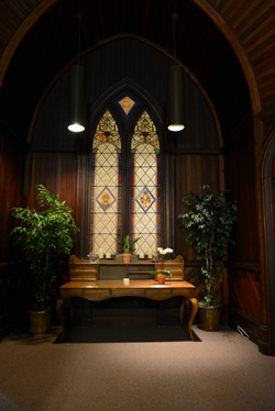 A peaceful alcove at the church welcomes visitors. The sanctuary is now used by McDermott-Crockett Mortuary for services. (Jenn Kennedy / Noozhawk photo)