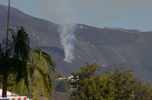 Smoke rises from the Cold Fire above Montecito Tuesday, as viewed from downtown Santa Barbara. (Tom Bolton / Noozhawk photo)