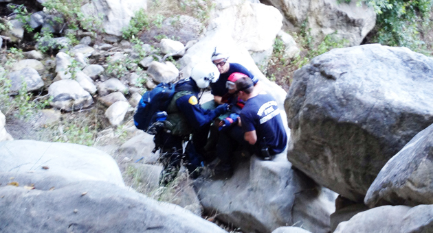 Rescue personnel tend to a 9-year-old girl who was injured in a fall while hiking in Cold Springs Canyon above Montecito Thursday. (Santa Barbara County Search & Rescue photo)